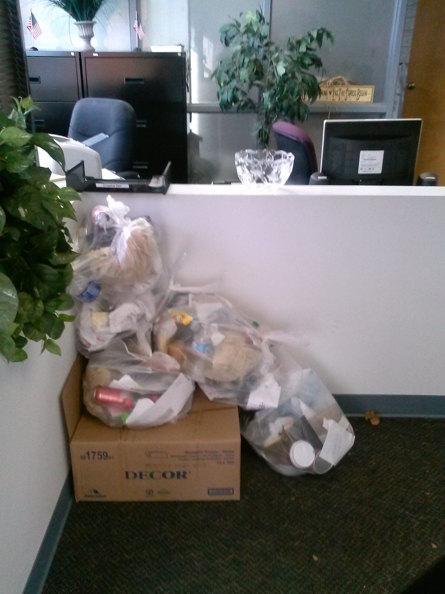 Garbage piled up in eShowings office, Courtesy of Kia Cale.