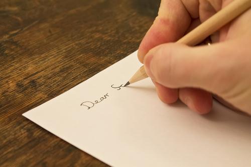 Letter writing image via Shutterstock.