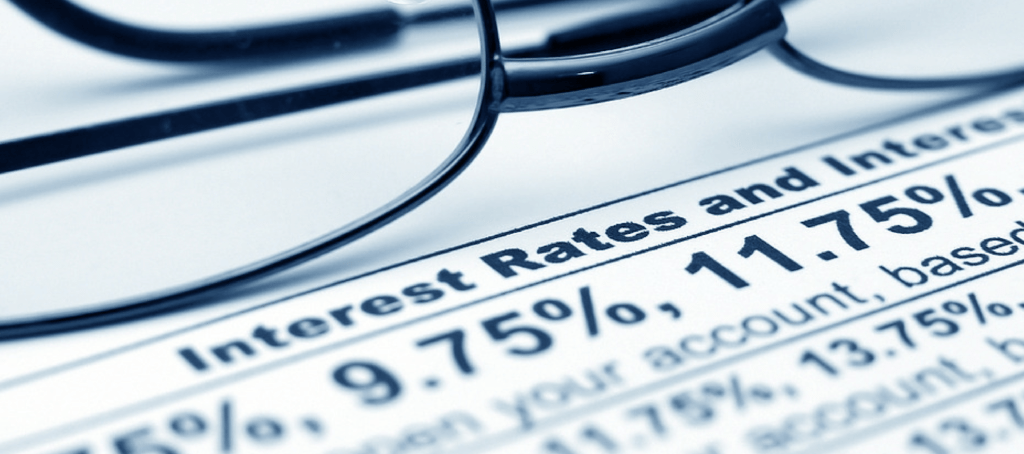 Interest rates image via Shutterstock. Modified.