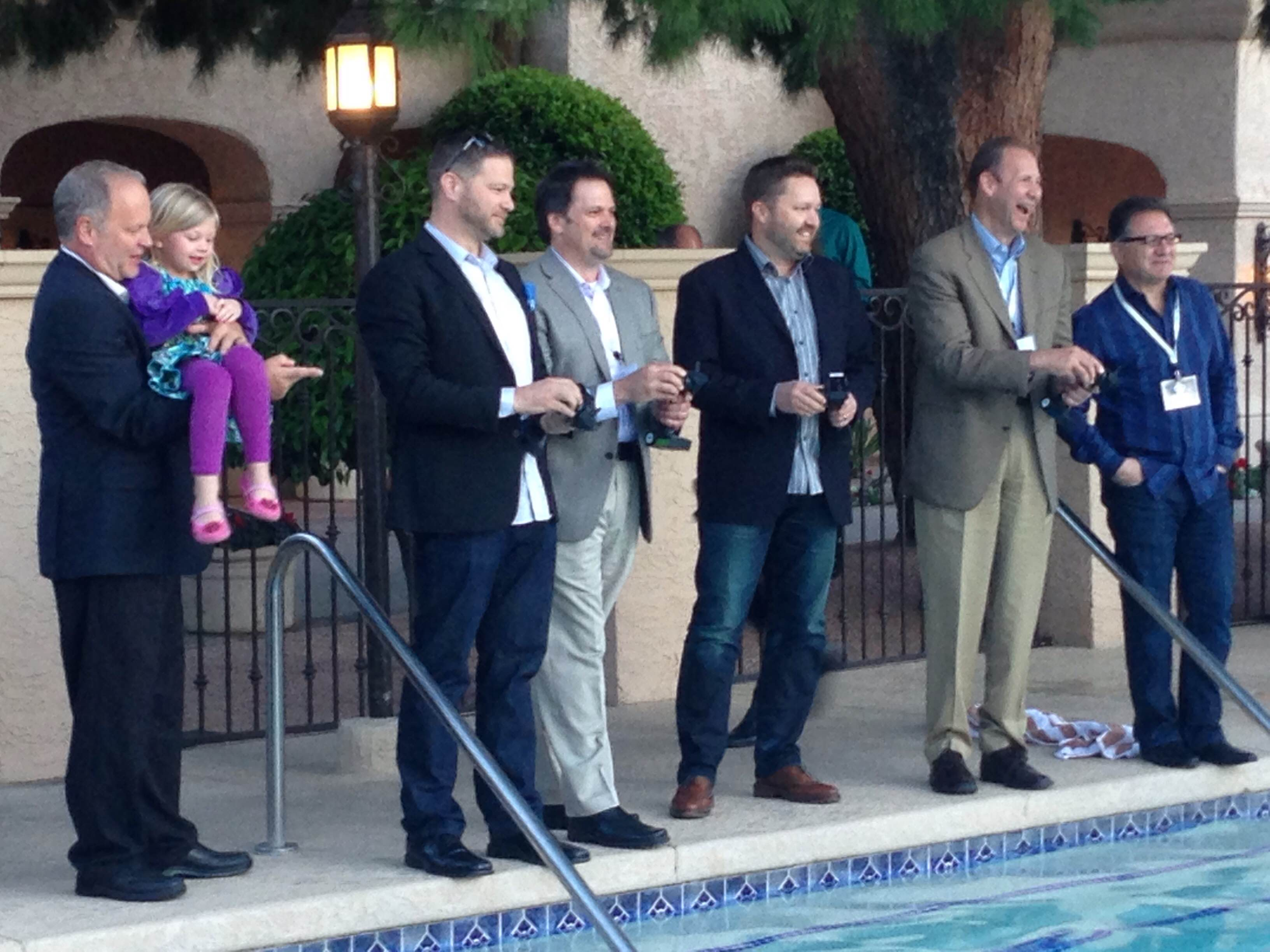 Zillow's Steve Allen, Trulia's John Whitney, Homes.com's Andy Woolley and Move's Russ Cofano compete in a boat race.