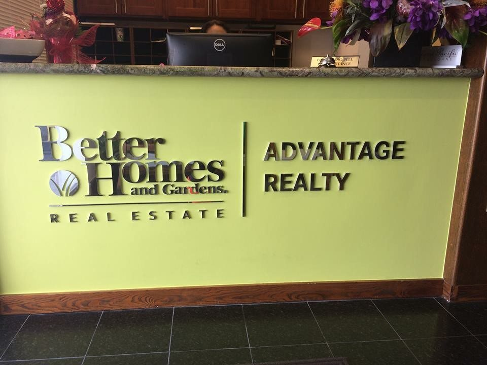 Signage at Better Homes and Gardens Advantage Realty via Sherry Chris @sherrychris