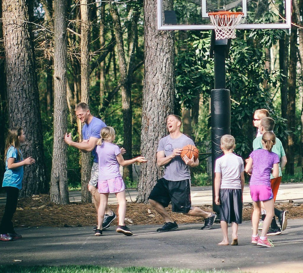 Benham playing basketball with his family.