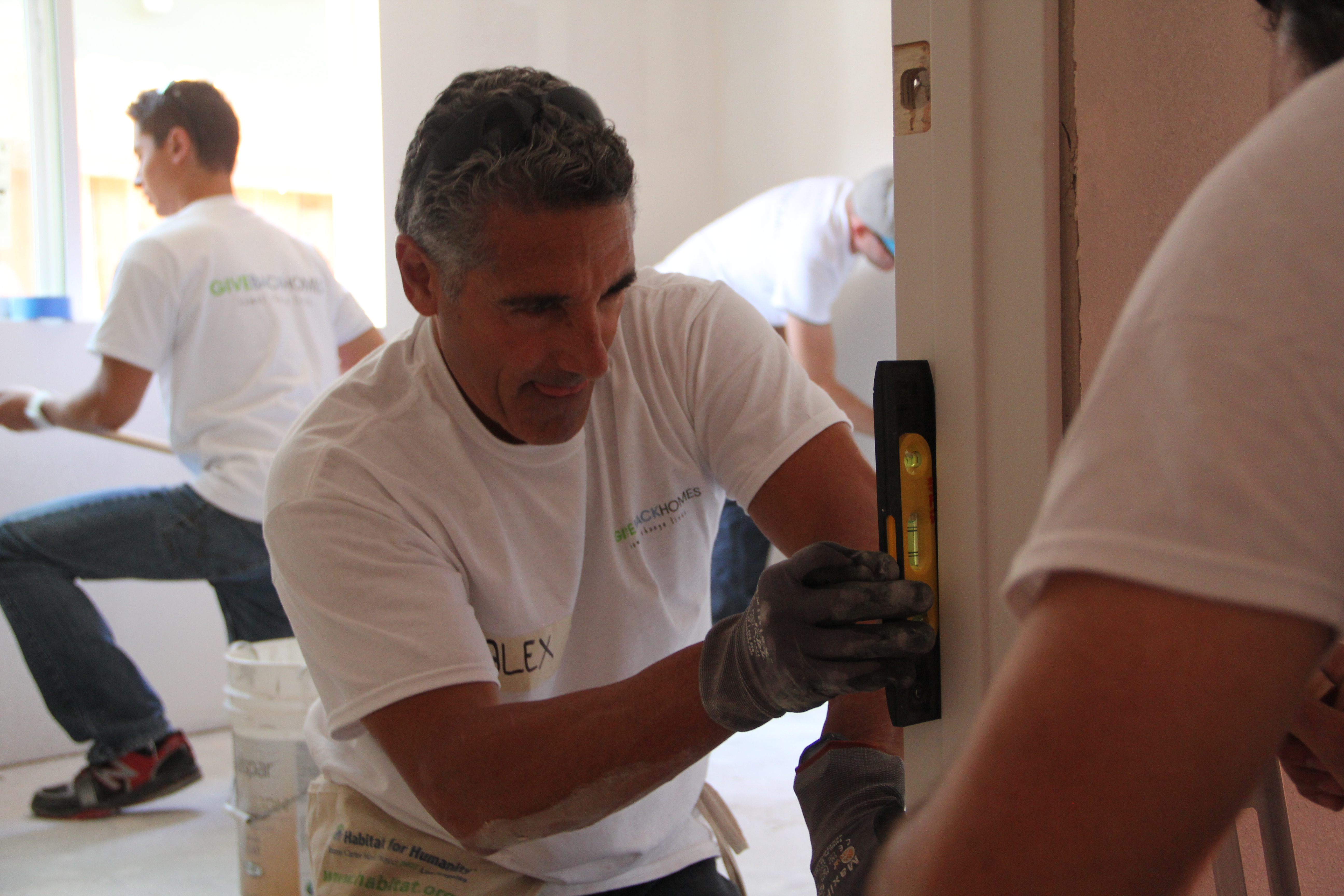 Alex Abad chips in during a 'build day' in Los Angeles, when volunteers helped construct a home for a needy family.
