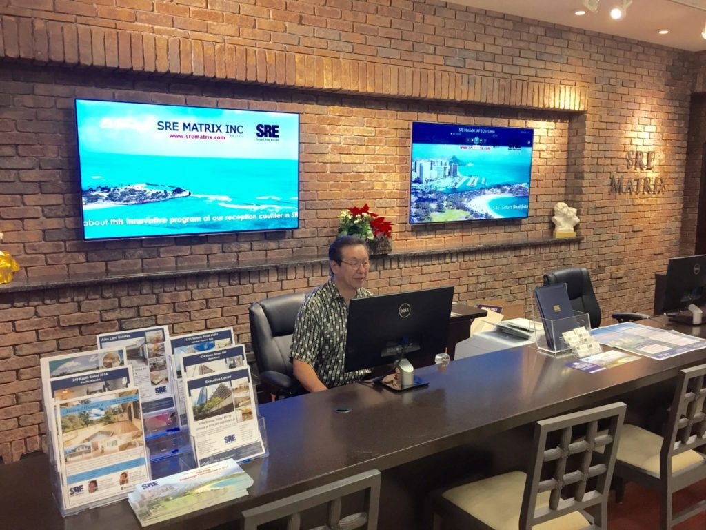 An SRE Matrix agent mans the service counter at the brokerage's Honolulu office.