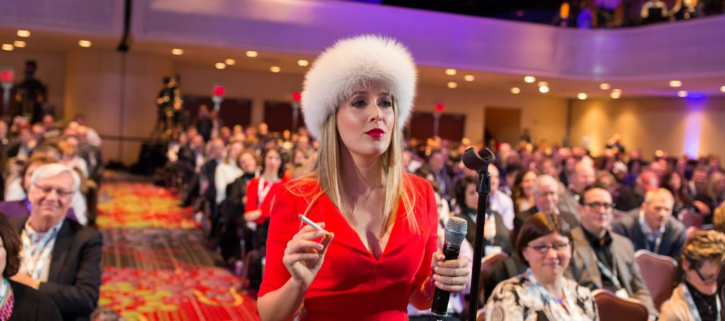 "Realtor Cristina Cote in a red dress and furry hat as her alter ego ""Svetty."""