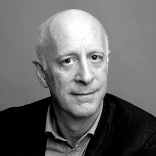 A black-and-white photograph of Paul Goldberger