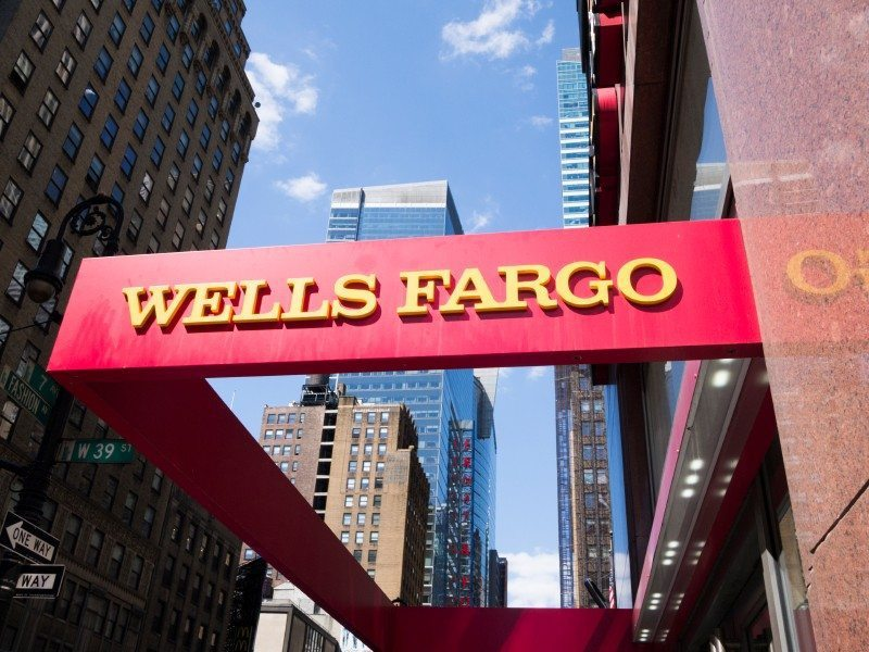 New York, New York, USA - May 31, 2012: A Wells Fargo sign at a Wells Fargo location in Midtown Manhattan. Manhattan buildings can be seen in the background. [url=/my_lightbox_contents.php?lightboxID=3623142]Click here for more[/url] New York images and video.
