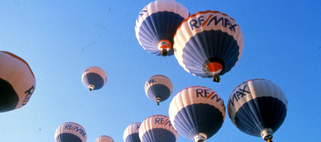 Re/Max balloons in the sky.