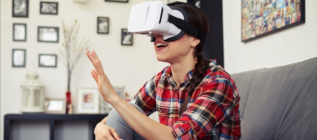 A woman wearing virtual reality goggles