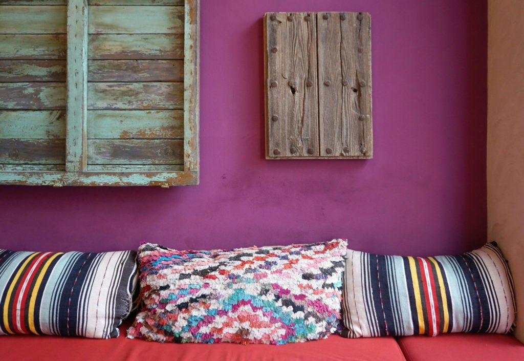 ethnic print pillows on a couch