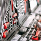 A man's hands selecting tools