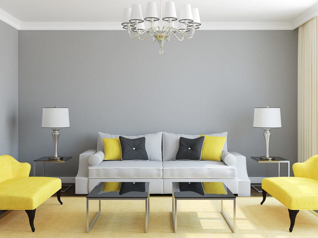 A room decorated in gray with pops of color