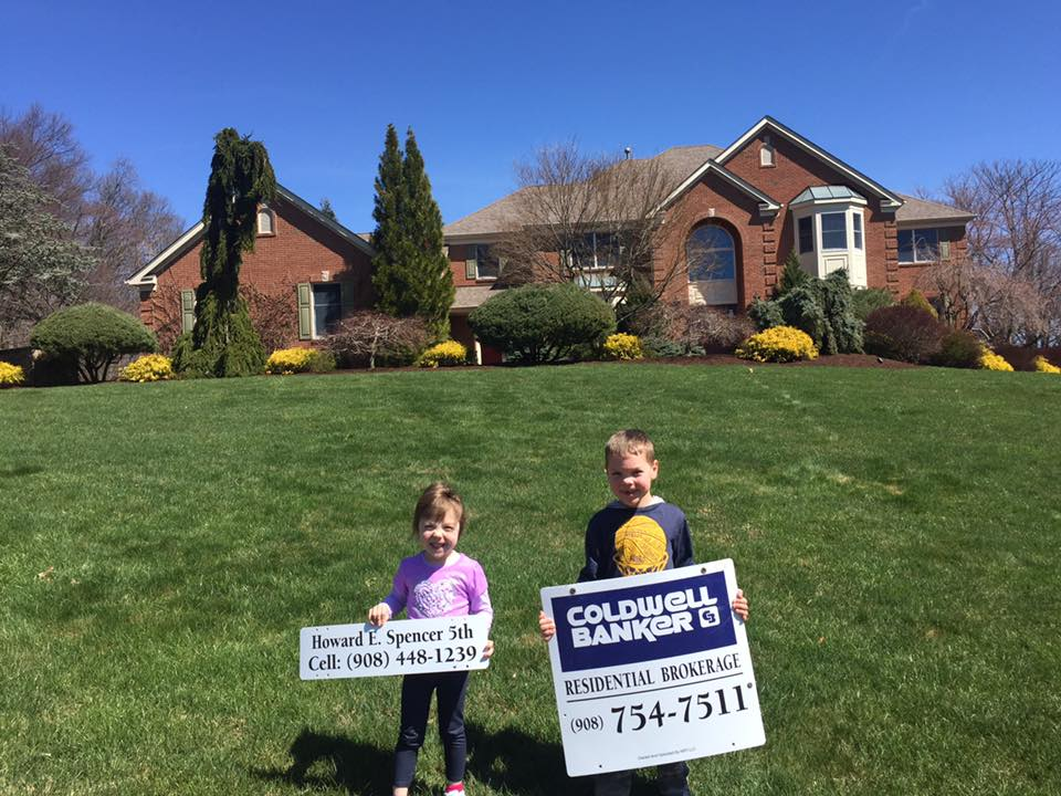 'The kids love putting up signs with me,' says Frenchtown, New Jersey-based Realtor Howard Spencer.