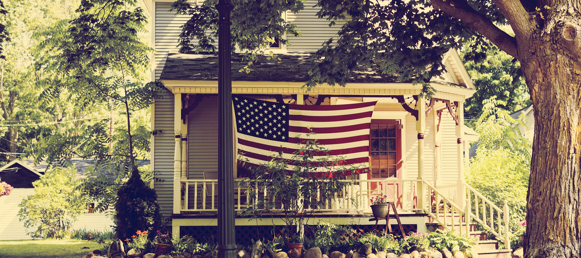 An American flag in front of a home