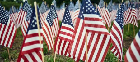 These agents are handing out 11,000 American flags this Fourth of July
