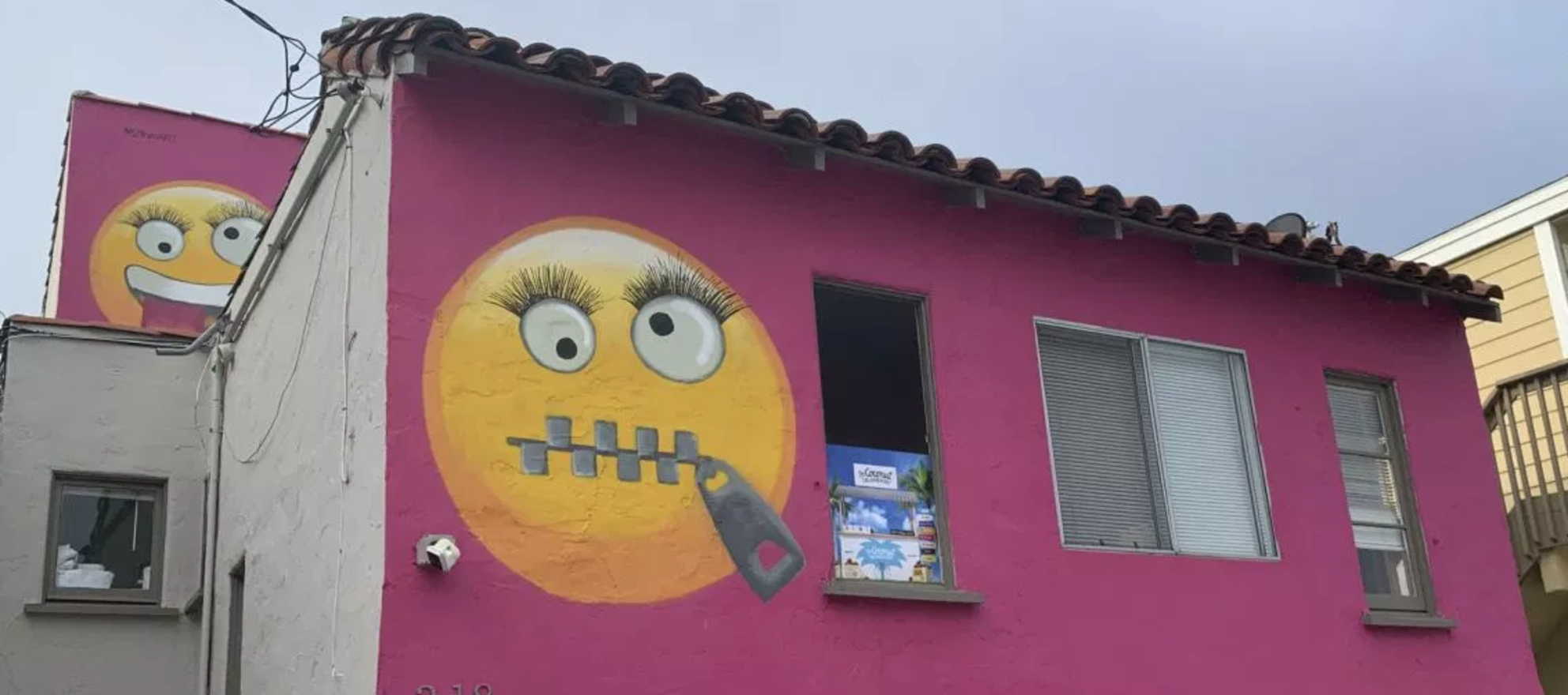 Pink emoji house that caused neighborhood furor up for sale