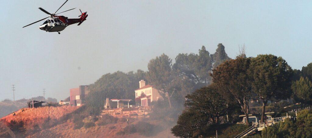Fires imperil wealthy Los Angeles neighborhoods, celebrity homes