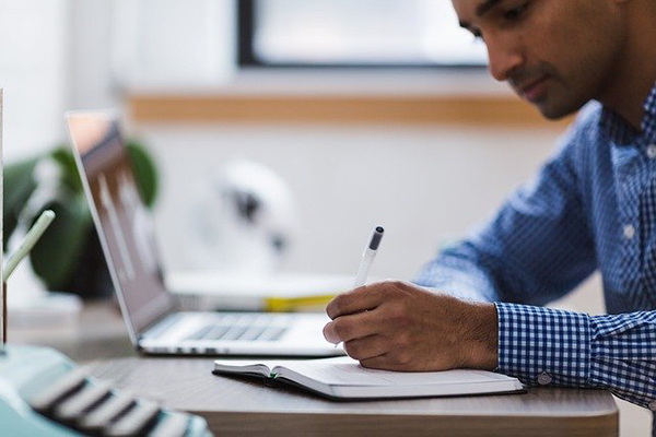 man concentrating on paperwork