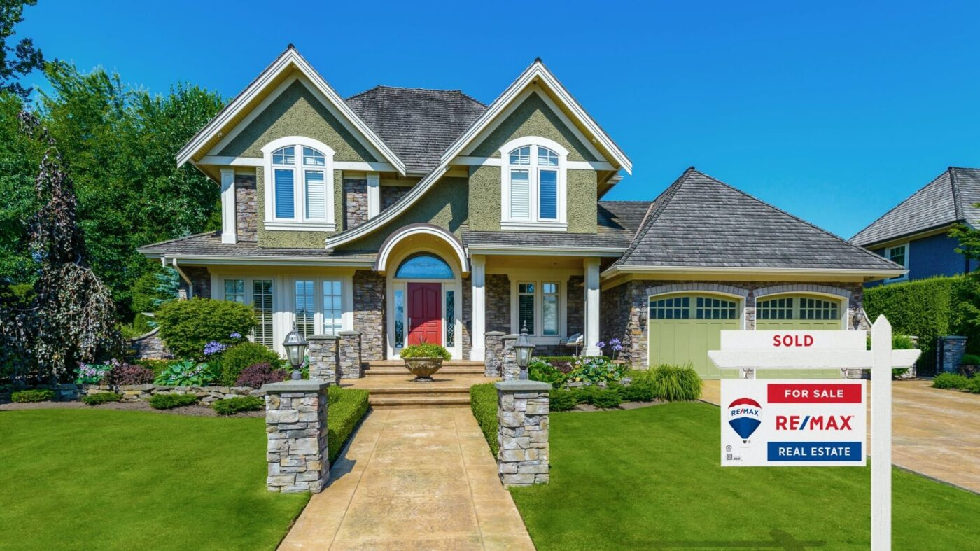 RE/MAX expands broker fee deferrals, enacts hiring freezes