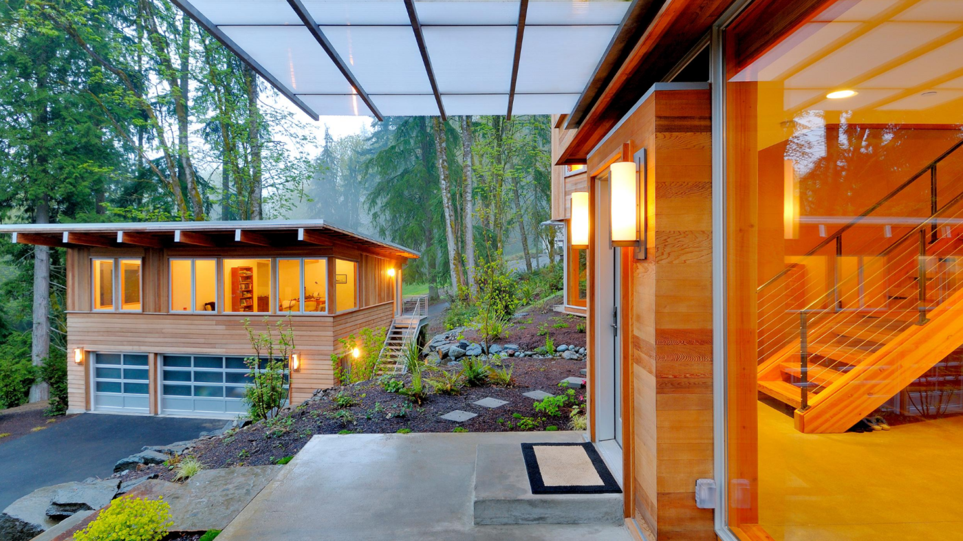 All-glass garage doors instantly breathe life into an old home