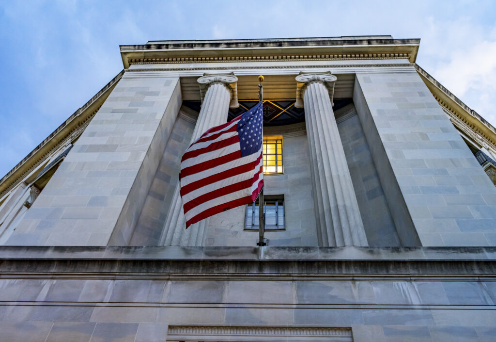 Facade FlagsJustice Department Building Pennsylvania Avenue Washington DC Completed in 1935. Houses 1000s of lawyers working at Justice.